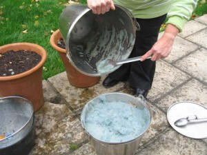 Scraping out the last of the froth that contains the blue pigment