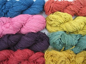 Naturally-dyed cotton mordanted with alum acetate. Clockwise from left to right: indigo, brazilwood, weld, weld + indigo, fustic, madder, logwood, cochineal